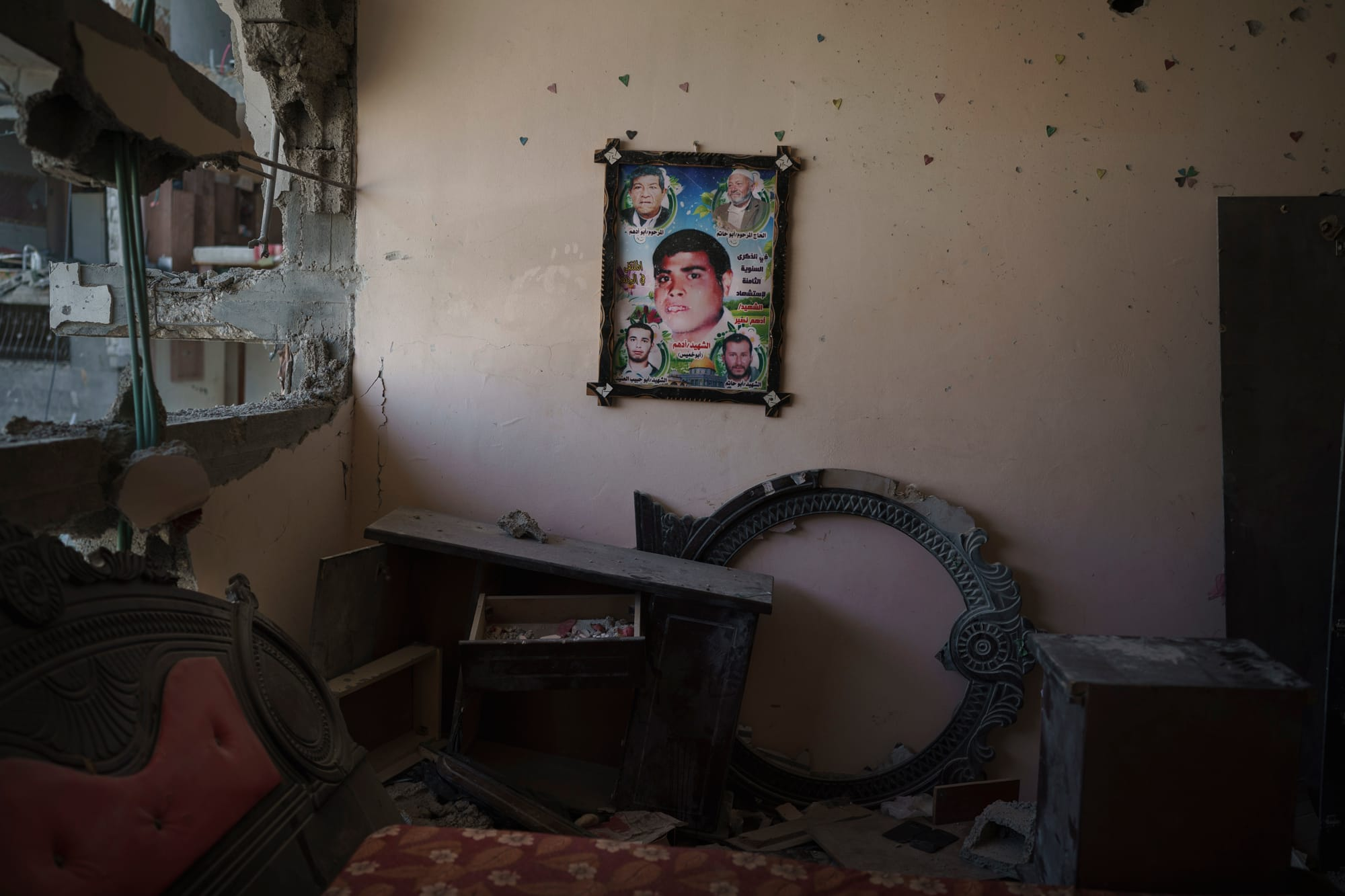 A poster with a photo of a man who died in the 2008 war hangs on the wall of his widow's house.